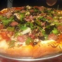 Photo taken at Gianni's Pizza by Lenna E. on 11/6/2011