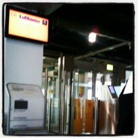 Photo taken at Gate A74 by Izah E. on 7/6/2012
