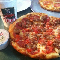 Photo taken at Dion's Pizza by Juliana R. on 6/18/2012