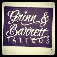 Photo taken at Grinn and Barrett Tattoo Studio by Portia B. on 5/16/2012