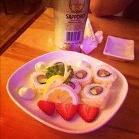 Photo taken at Yoki Japanese Restaurant and Sushi Bar by Gloria C. on 3/22/2012
