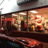 Photo taken at Krispy Kreme Doughnuts by Melanie M. on 7/14/2012