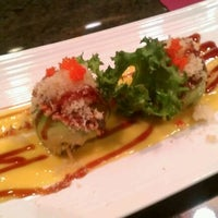 Photo taken at Mojo Asian Cuisine & Sushi Bar by Whitnie-rae H. on 4/7/2012