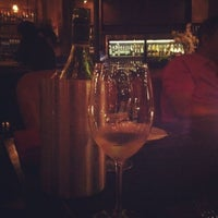Photo taken at D' vine Wine Bar & Tapas by Nongnat P. on 3/9/2012