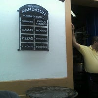 Photo taken at Mandalun Restaurante by Victor P. on 2/12/2012