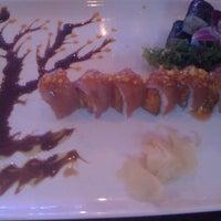 Photo taken at Umami Sushi by Melanie G. on 4/28/2012
