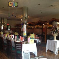 Photo taken at Sally's West Indian Restaurant by Kimi M. on 6/5/2012