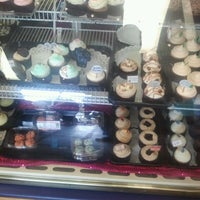 Photo taken at Carolina Cupcakery at Ghent Skinny Dip by Rosalind on 7/30/2012
