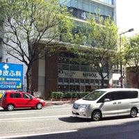 Photo taken at Tsutaya Book Store Tenjin by Kazuya K. on 8/4/2012