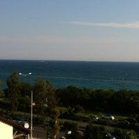 Photo taken at Ακτή του Ήλιου by Diek R. on 6/1/2012