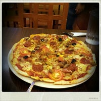 Photo taken at Handuraw Pizza by Francis C. on 7/31/2012