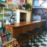 Photo taken at Gilly's Craft Beer & Fine Wine by Charles C. on 6/13/2012