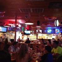 Photo taken at Hooters by Humberto J. on 7/22/2012
