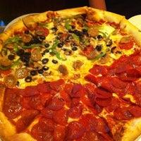 Photo taken at Dewey's Pizza by Adam W. on 7/20/2012