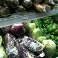 Photo taken at Village Grocer by Ted C. on 6/23/2012