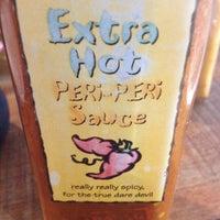 Photo taken at Nando's by Christina T. on 2/20/2012