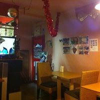 Photo taken at Merah Putih Cafe by Akira Y. on 3/10/2012