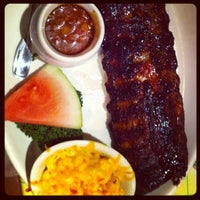 Photo taken at Lucille's Smokehouse Bar-B-Que by Hell C. on 4/2/2012
