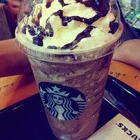 Photo taken at Starbucks by Yingying C. on 3/2/2012