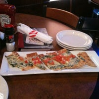 Photo taken at TGI Fridays by Christopher B. on 6/13/2012