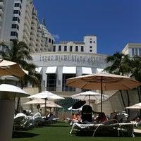 Photo taken at Loews Miami Beach Pool by L L. on 8/21/2011