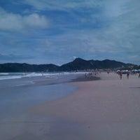 Photo taken at Praia do Mariscal by Charles W. on 1/1/2011