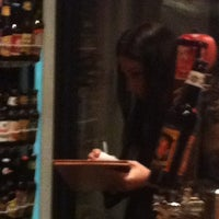 Photo taken at The Wine Rack / Java Stop Cafe by Richard D. on 2/18/2012