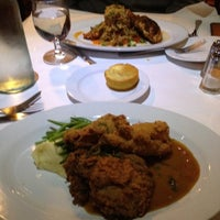 Photo taken at Creola: A New Orleans Bistro by Anna L. on 1/19/2012