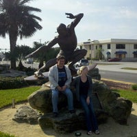 Photo taken at Kelly Slater Statue by James H. on 1/7/2012