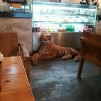 Photo taken at ZOO COFFEE by Sam L. on 11/24/2011
