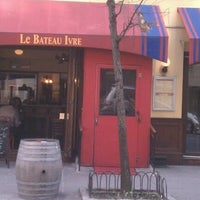Photo taken at Le Bateau Ivre by Melissa B. on 3/12/2012