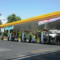 Photo taken at Shell by Francisca D. on 12/8/2011