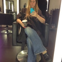 Photo taken at Scott J Aveda Salon Spa by Katie B. on 3/6/2012