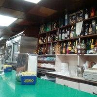 Photo taken at El Hipopotamo Restaurant & Delicatessen by Ezequiel R. on 8/10/2012