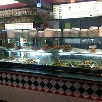 Photo taken at Singh's Roti Shop by Collin B. on 4/5/2012