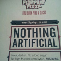 Photo taken at Flippin Pizza by Loren S. on 12/24/2011