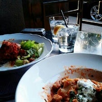 Photo taken at Trattoria Italian Kitchen by M X. on 8/28/2012