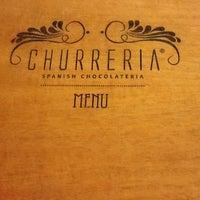 Photo taken at Churreria Spanish Chocolateria by Jenny H. on 12/8/2011
