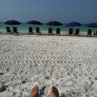 Photo taken at Miramar Beach by Devan S. on 7/3/2012