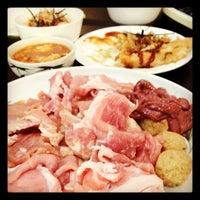 Photo taken at Shinyuu Shabu Shabu & Okonomiyaki by Kentauji C. on 4/30/2012