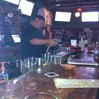 Photo taken at Mad Donkey Beer Bar & Grill by Melanie B. on 8/4/2011