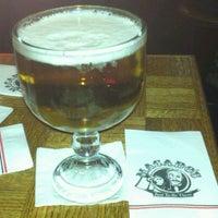 Photo taken at Macado's Restaurant & Bar by Erik W. on 11/17/2011