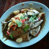 Photo taken at ริมเขื่อน (Rim Khuean Restaurant) by Chonchalarm A. on 1/14/2012