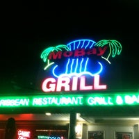 Photo taken at MoBay Caribbean Restaurant Bar & Grill by Paul C. on 3/17/2012