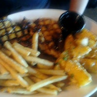 Photo taken at TGI Fridays by Cali F. on 1/23/2012