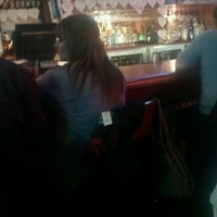 Photo taken at Boston's Restaurant & Sports Bar by Morgan F. on 1/15/2012