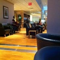 Photo taken at Wingtips Lounge by Gabriel B. on 12/6/2011