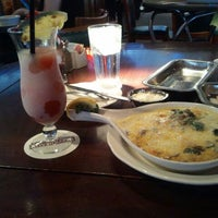 Photo taken at Pappadeaux Seafood Kitchen by Tanya on 1/10/2012