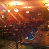 Photo taken at Mojitos Bar & Restaurant by Ty M. on 10/24/2011