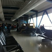 Photo taken at Gate 19 by Tomas M. on 6/3/2012